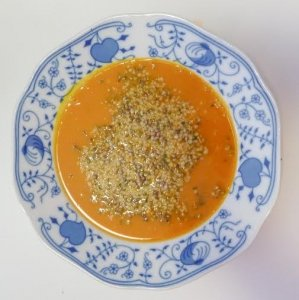 Exotic pumpkin cream soup with hemp seeds